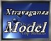 XTRAVAGANZA MODEL BADGE