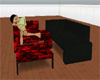 Red and black pose couch