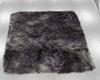 dark fur rug